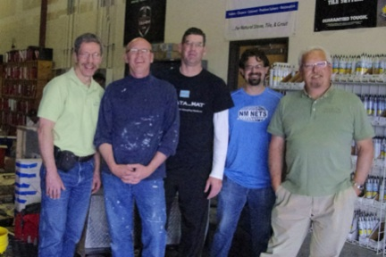 Amidst the Albuquerque Daltile warehouse where the April 12 CTI testing was taking place are (l. to r.): CTEF's Scott Carothers; Daltile's Bill Fergison; LATICRETE's Tim Evans; Daltile's Kevin Sebesta; and NTCA's Michael Whistler.