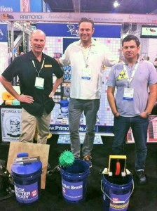 Inventors Phil Green (l.), Grant Jones (c.) and Steve Putnik, united at the BOE/Primo booth during the Coverings show.