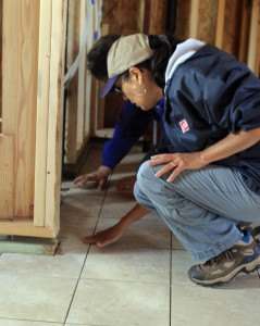 An all-female volunteer crew installed tile in three Habitat homes in Woodland Park, Co.