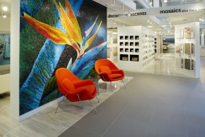The Daltile/KeysGranite Miami Design Studio welcomes visitors with a stunning byzantine glass mural of a bird of paradise flower.