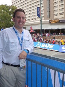 Jeremy Sax, Daltile's director of installation products sales,  helped cheer on the cyclists near the finish line.