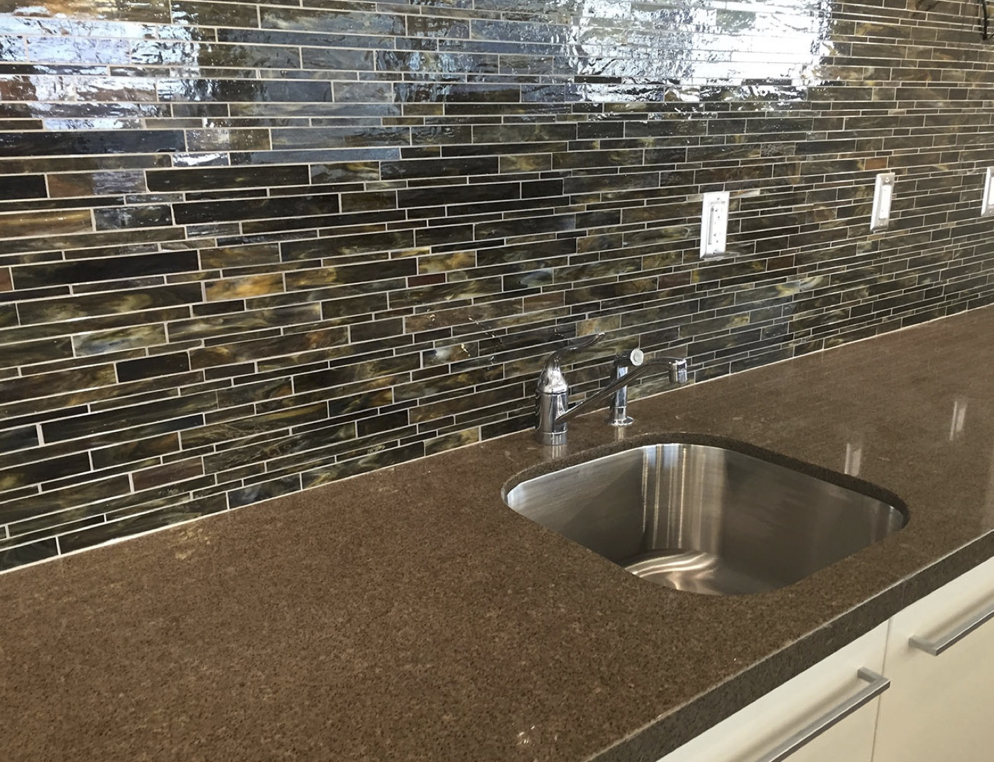 glass mosaic tiles used for the backsplash in one of the coffee bars