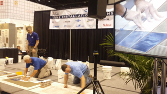 NTCA trainers (l. to r.) Mark Heinlein and Michael Whistler on the Live Installation Demonstration Stage, with an assist with NTCA Tennessee State Director Brad Denny, Nichols Tile & Terrazzo.