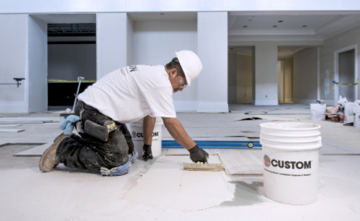 Subfloors for the Club at Ibis were first leveled with CUSTOM's LevelQuik® RS, then large and heavy tile was set with VersaBond®-LFT.
