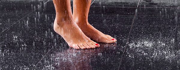 close up of woman's feet in large shower